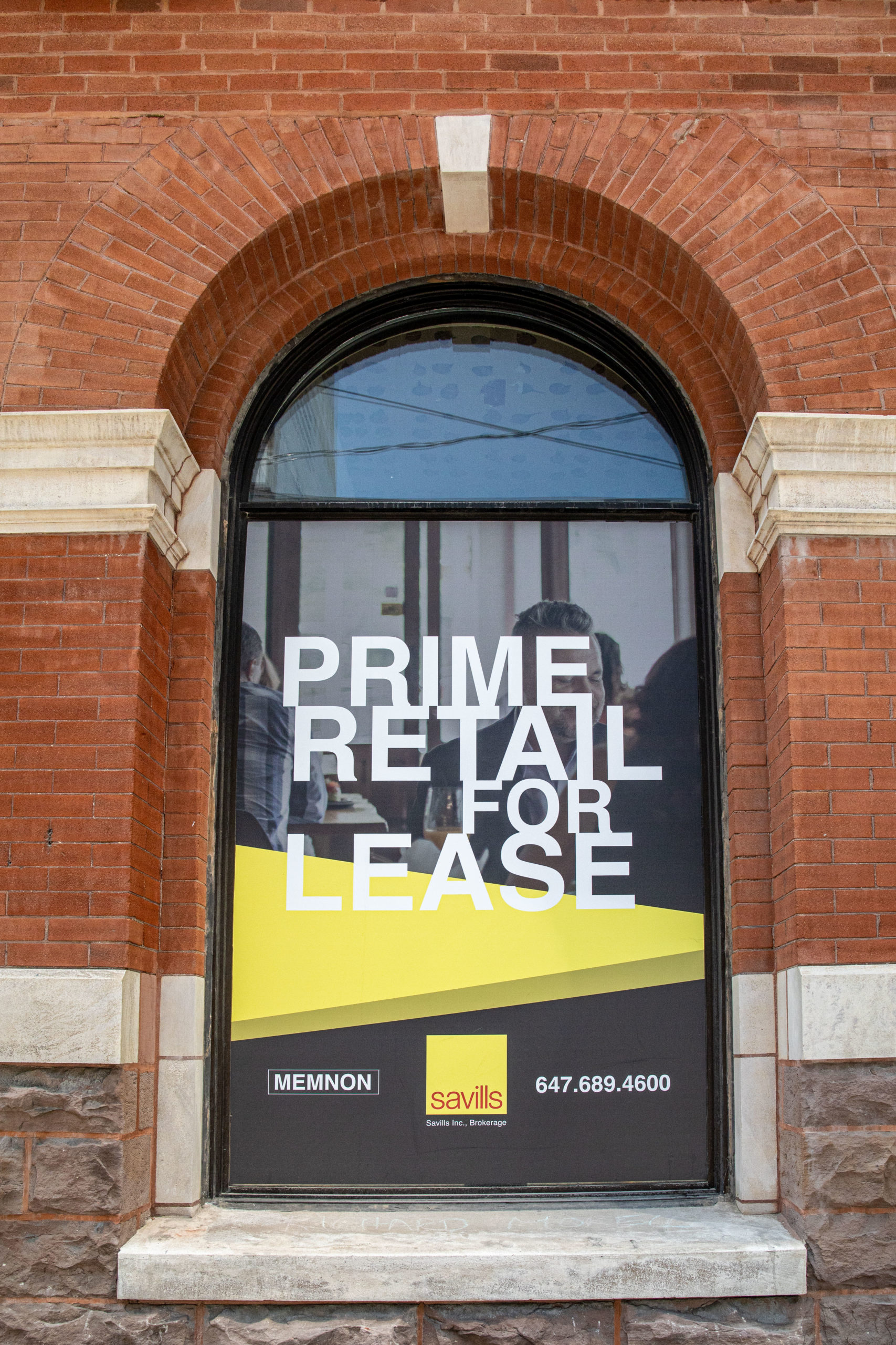 large format design print and installation of window signage on commercial building Queen Street East